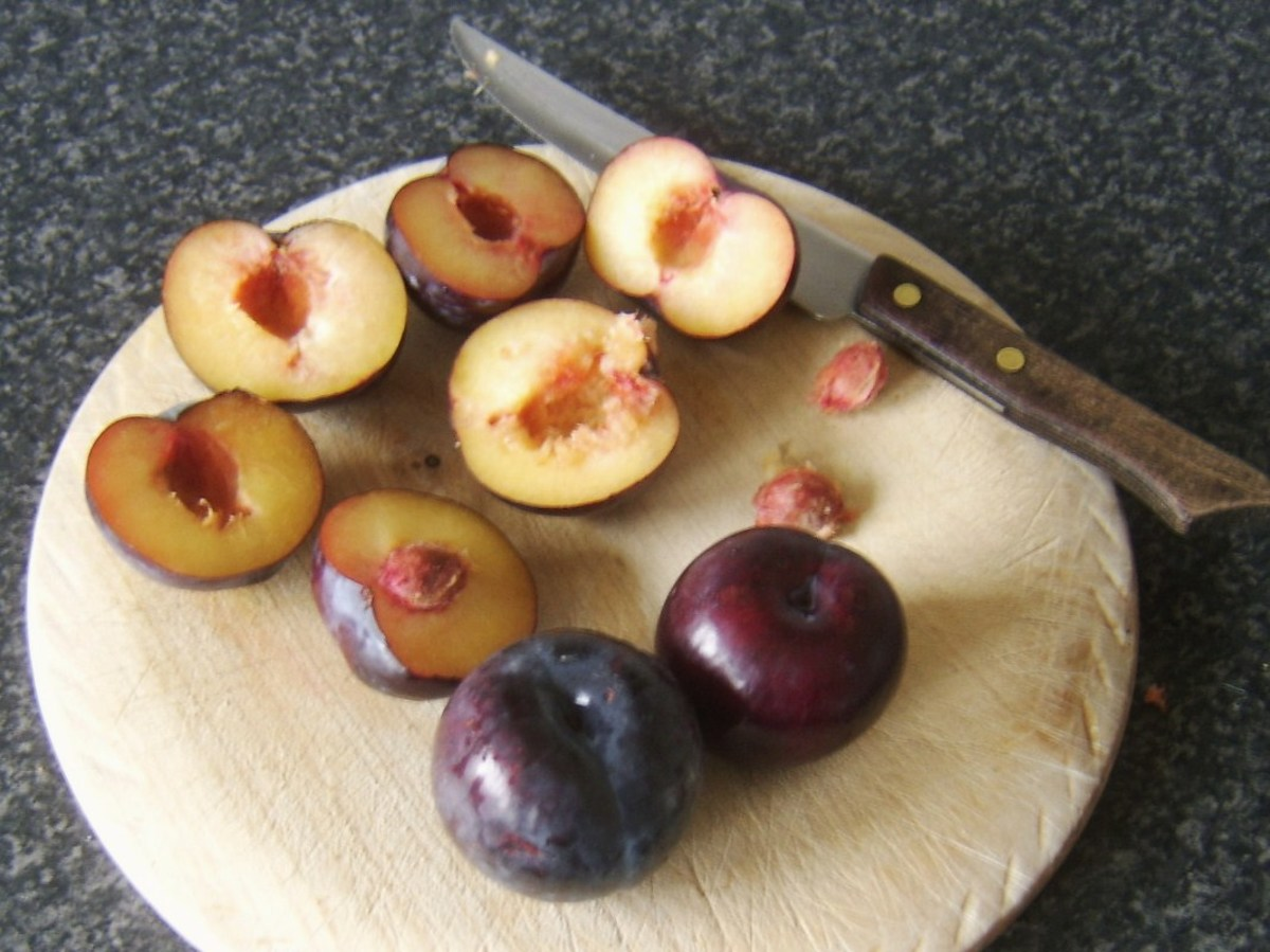 Chopping and de-stoning plums for stewing
