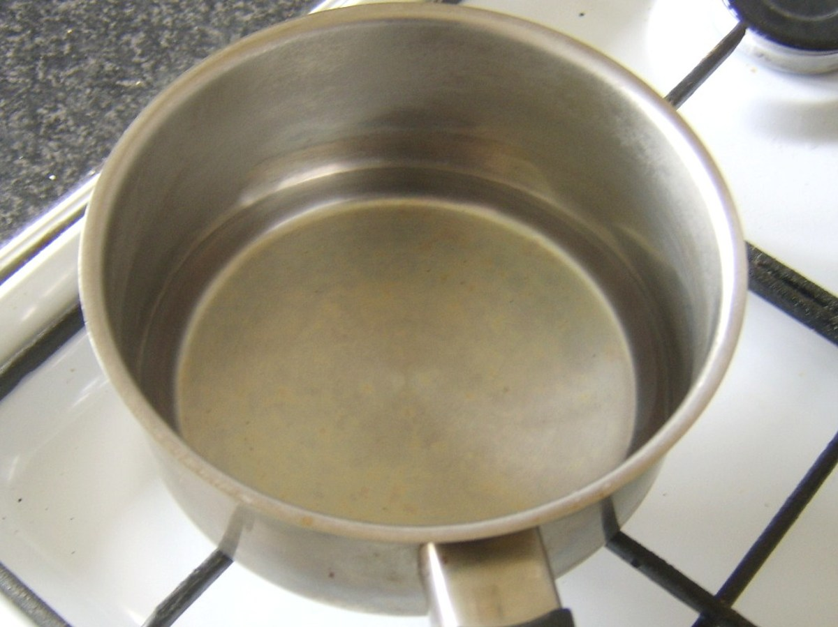 Shallow pan of simmering water