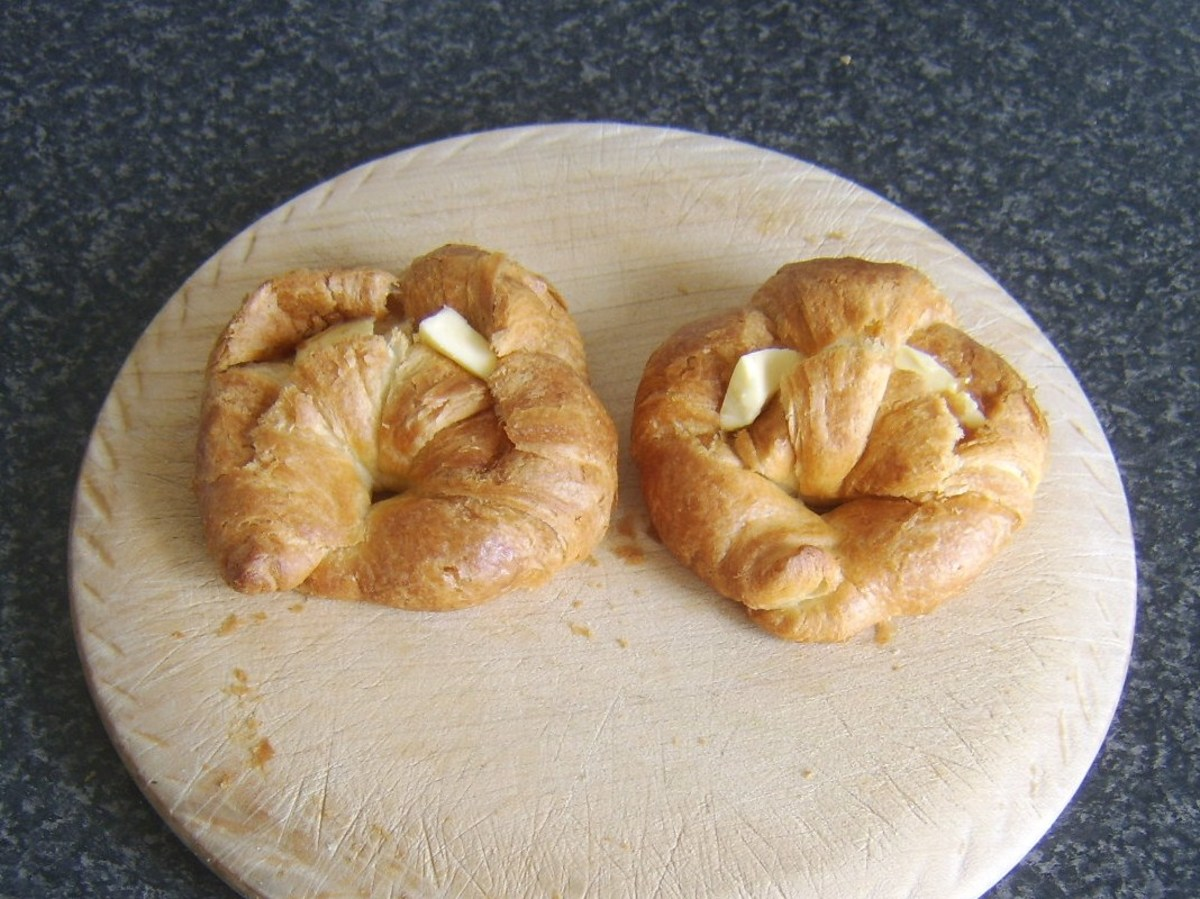 Croissants are slit open and buttered