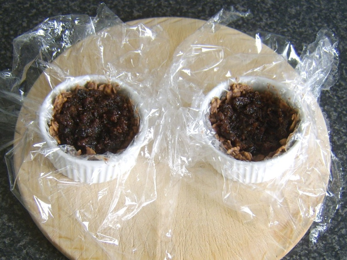 Christmas pudding is spooned in to chocolate cups
