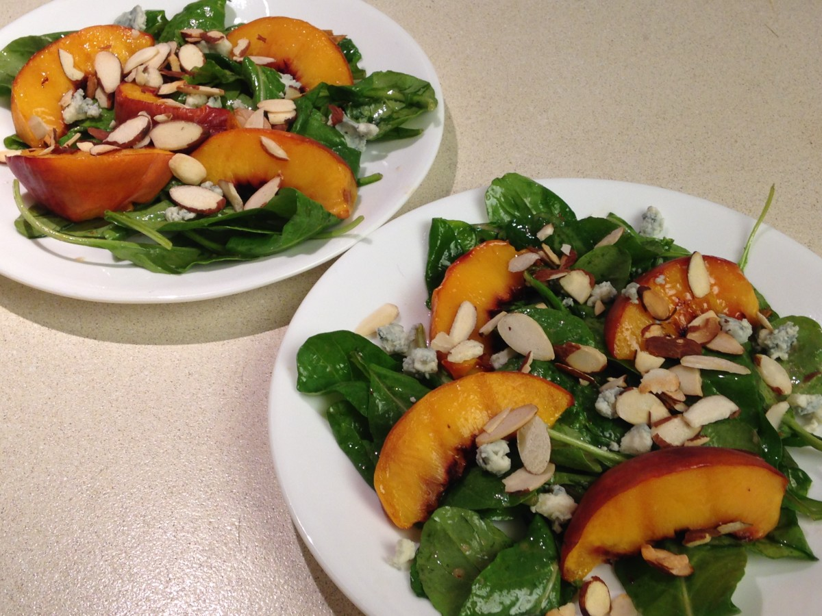 Arugula salad with grilled peach wedges and gorgonzola