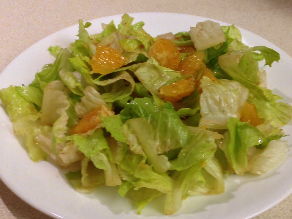 Romaine lettuce with orange pieces