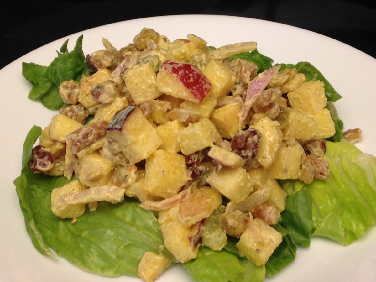 Waldorf Salad with Red Delicious and Fiji apples, raisins, and nuts, on a bed of Romaine lettuce