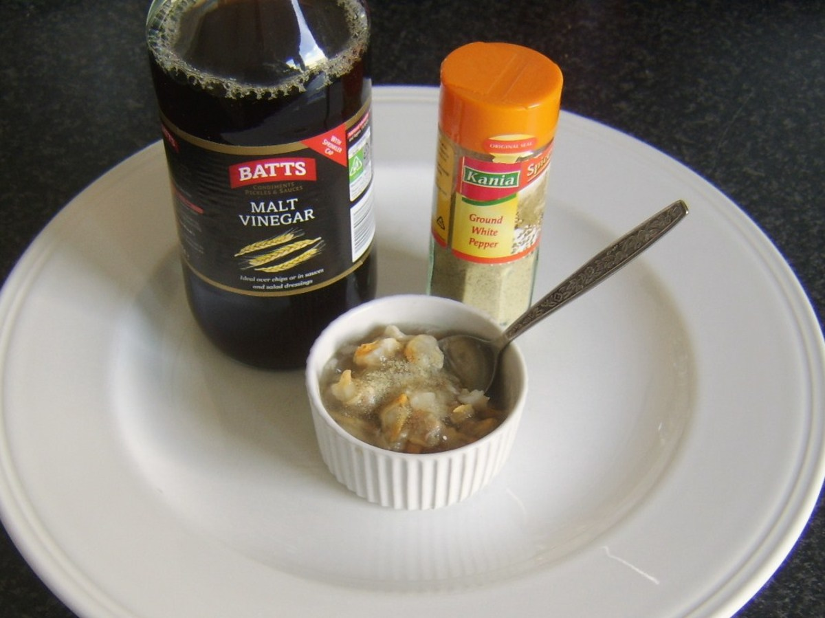 Malt vinegar and white pepper are added to jellied conger eel and cockles