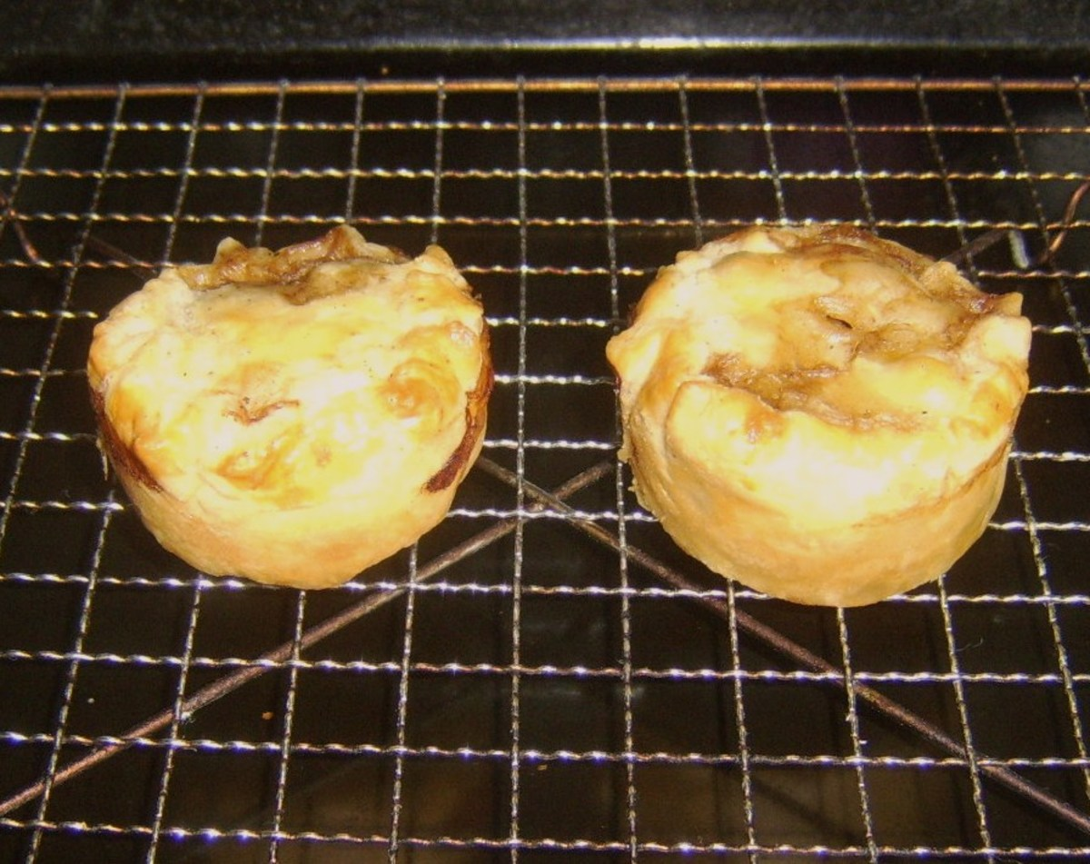 Puff pastry steak pies are rested on wire rack