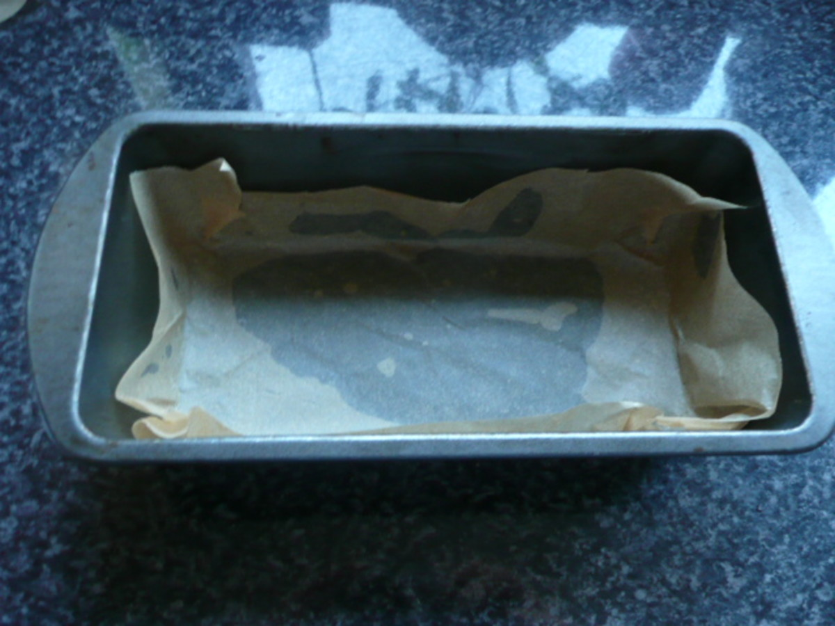 Lining a tin with greaseproof paper makes it easy to remove the chocolate