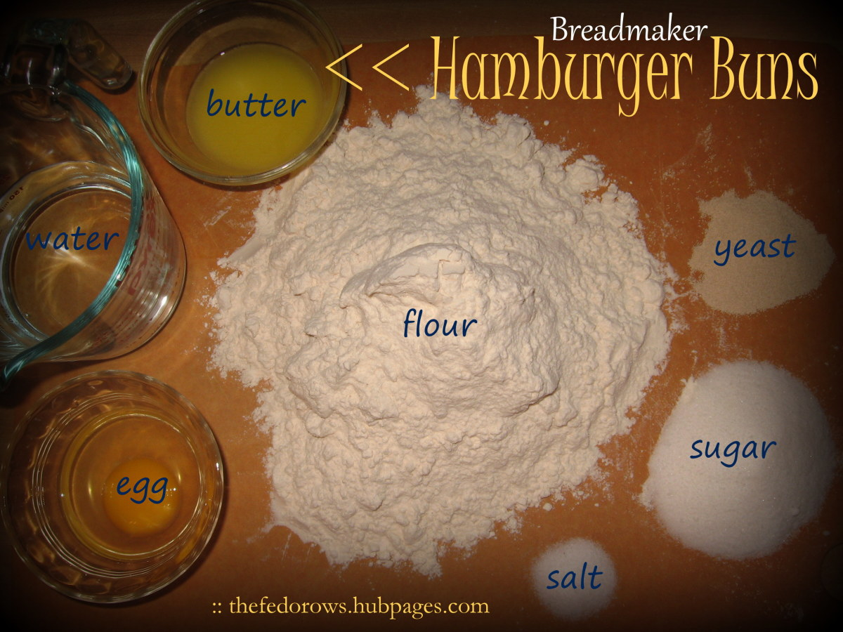 To make breadmaker buns you'll need melted butter, water, egg, flour, salt, sugar, and yeast.