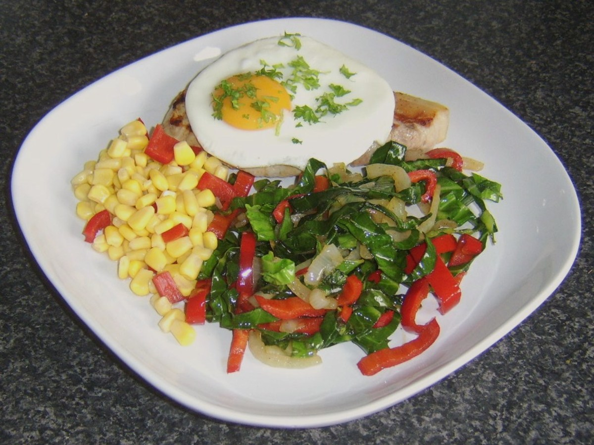 Griddled cabbage and sweet pepper with pork chop and fried egg