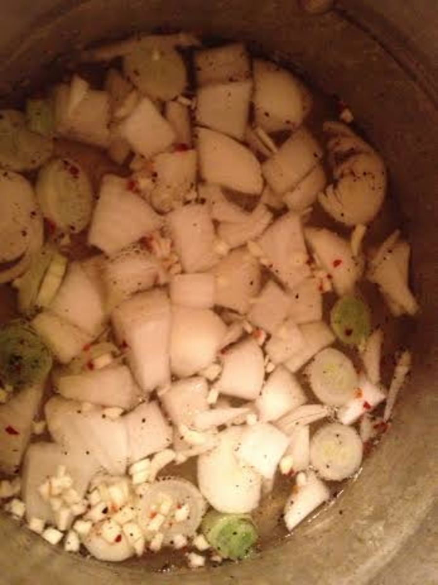 Add your onion, pepper, garlic and red pepper flakes if you are using them.  Allow this to simmer for a few minutes.