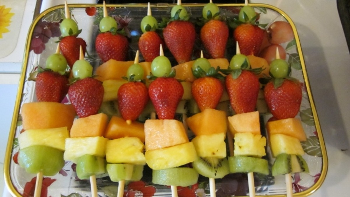 Color coordinated fruit salad kabobs make an appealing presentation.