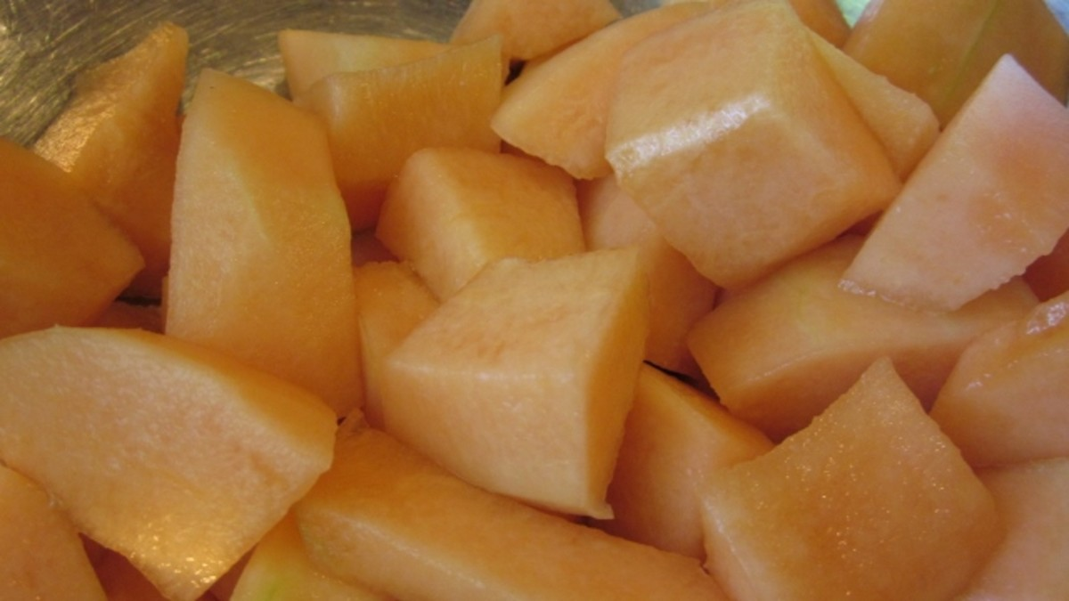 Cantaloupe is cut into large chunks.