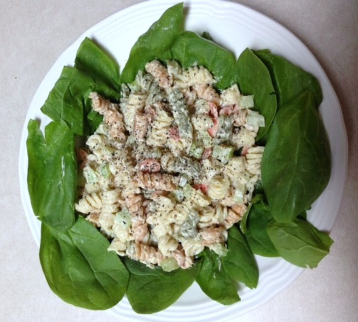 Chilled Tuna Pasta Salad on a bed of Spinach