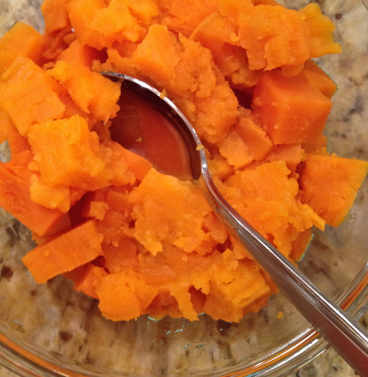 In a separate bowl, slightly mash about two cups of cooked sweet potato.