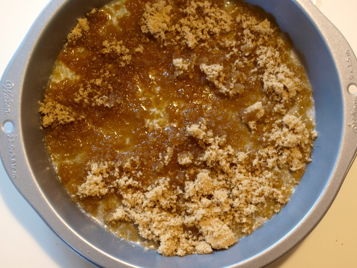 Sprinkle the brown sugar evenly over the melted butter.