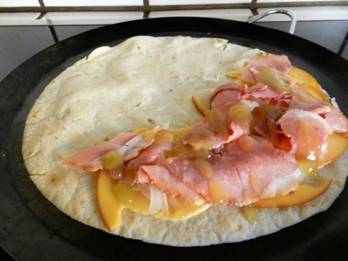 Flip tortilla and put on filling