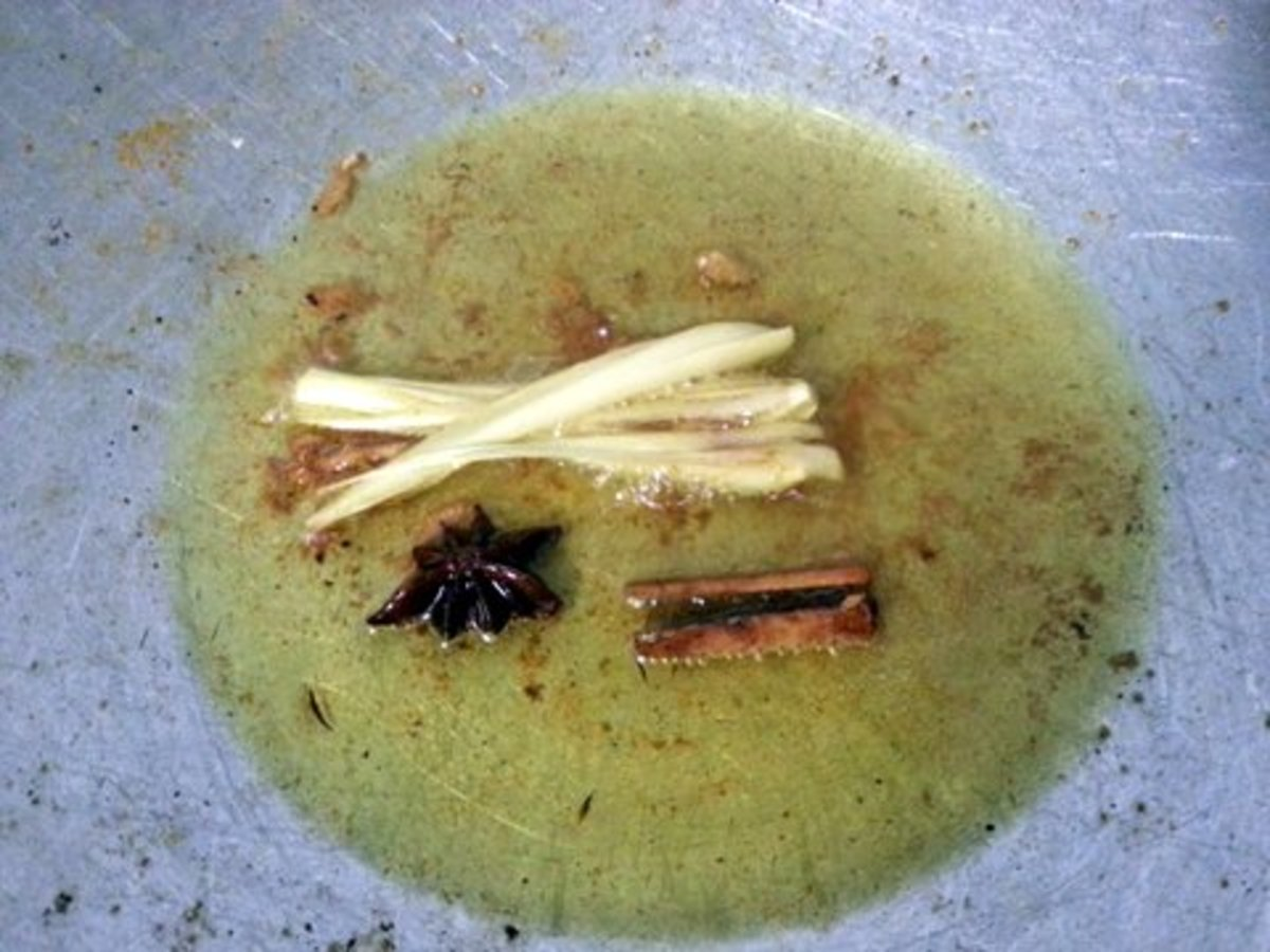 7. Using the same cooking oil that was used for frying the chicken, fry the cinnamon, star anise and lemon grass until you get the fragrance.