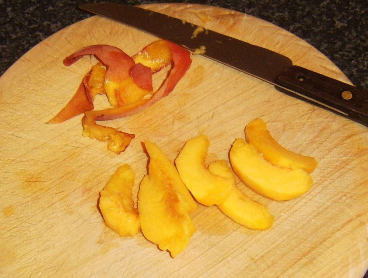 Peach half is peeled and sliced