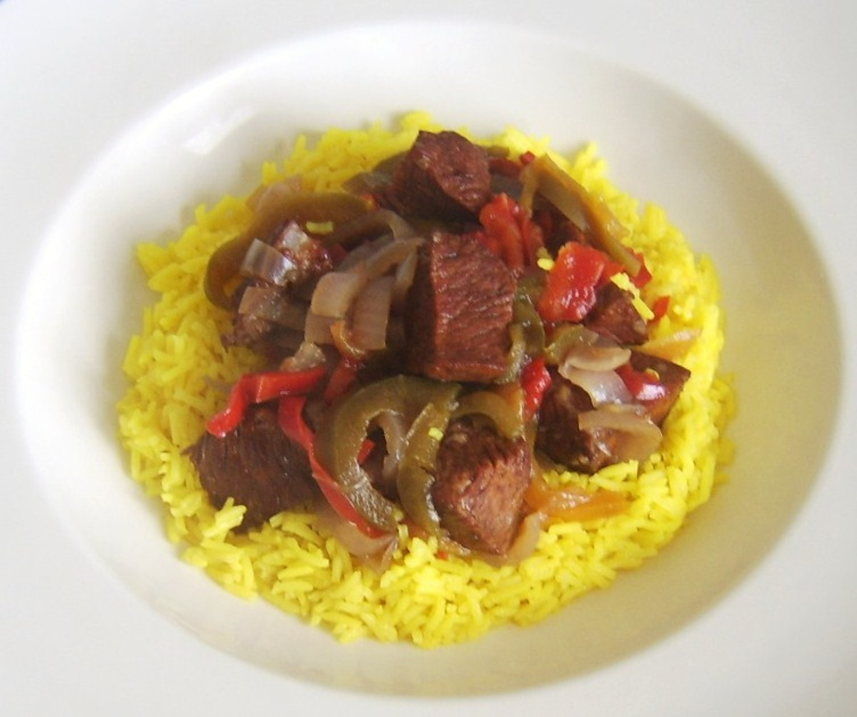 Ostrich casserole is spooned on to spicy rice bed