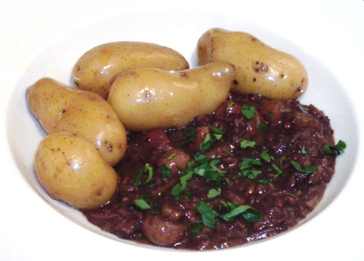 Autruche au Vin (Ostrich slowly stewed in red wine) with new potatoes)