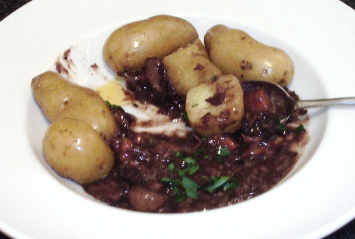 Enjoying autruche au vin with new potatoes