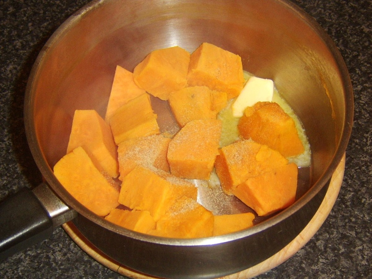 Butter and nutmeg are added to sweet potatoes