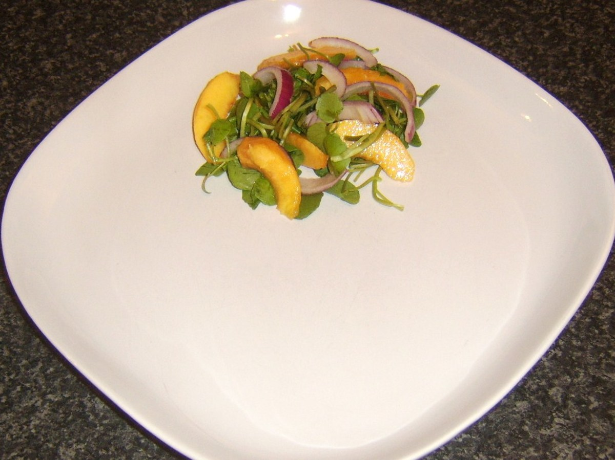 Peach and watercress salad is plated