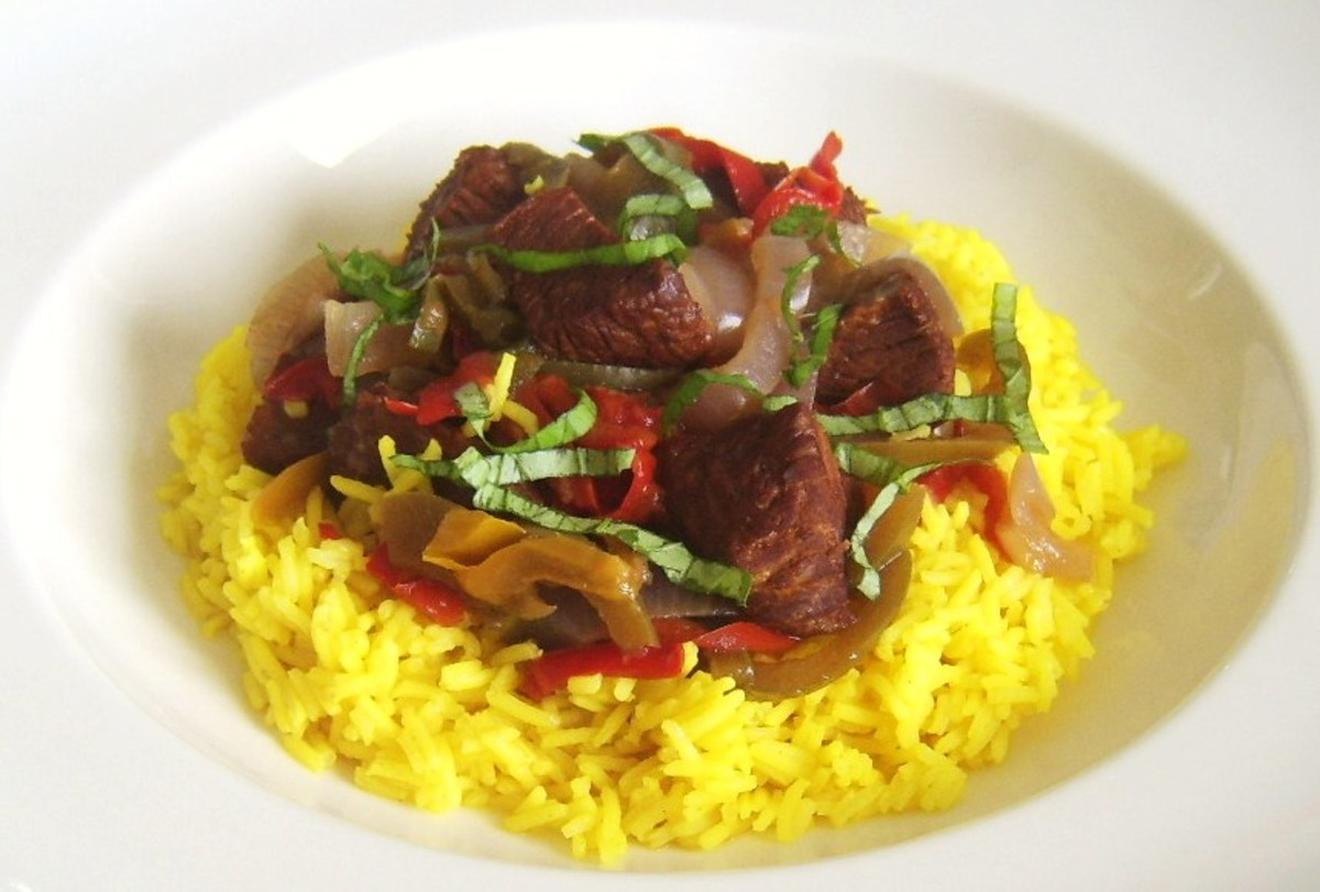 Casseroled ostrich with mixed peppers is served on a bed of turmeric spiced rice