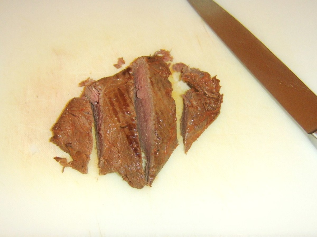 Griddled and rested ostrich steak is sliced