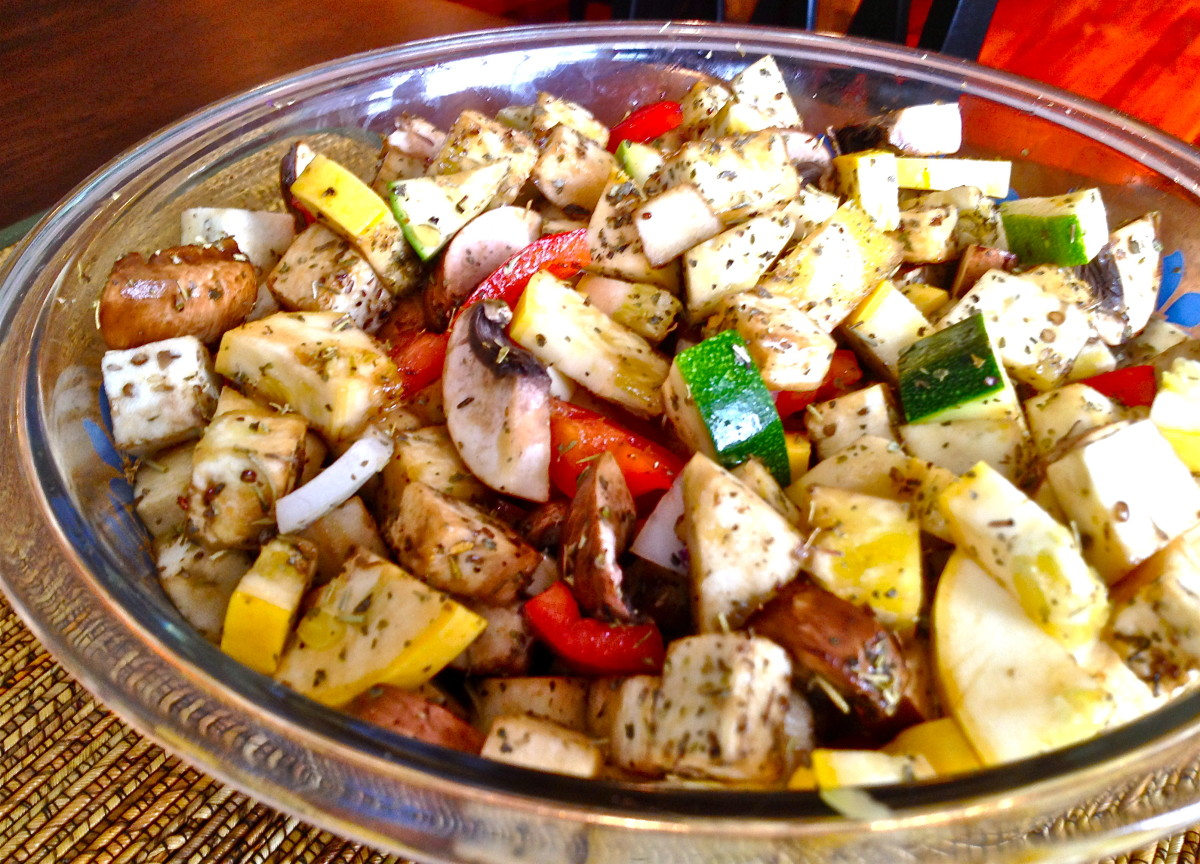 Toss veggies with in a large glass bowl with oil, vinegar, and spices (see above picture).