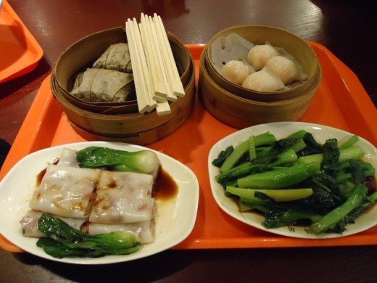 A collection of delicious Chinese dishes.  Pans are used in Chinese cookery for frying, boiling, and steaming. Traditionally the food is then eaten with chopsticks, although Westerners sometimes prefer knives, forks, or spoons.