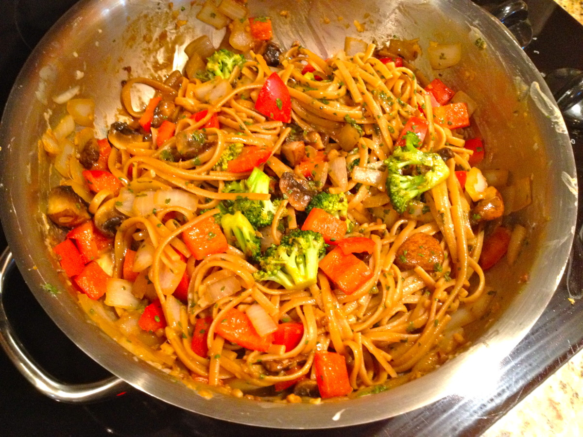 Add pasta and cook for 1 to 2 minutes or until thoroughly heated, stirring well. Top with optional cilantro and peanuts.