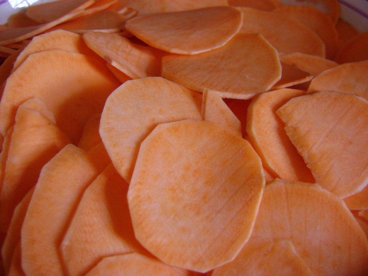 Once the oil is hot and ready to go, I start cooking the sweet potato slices, while they cook, I continue to peel and slice to save time.