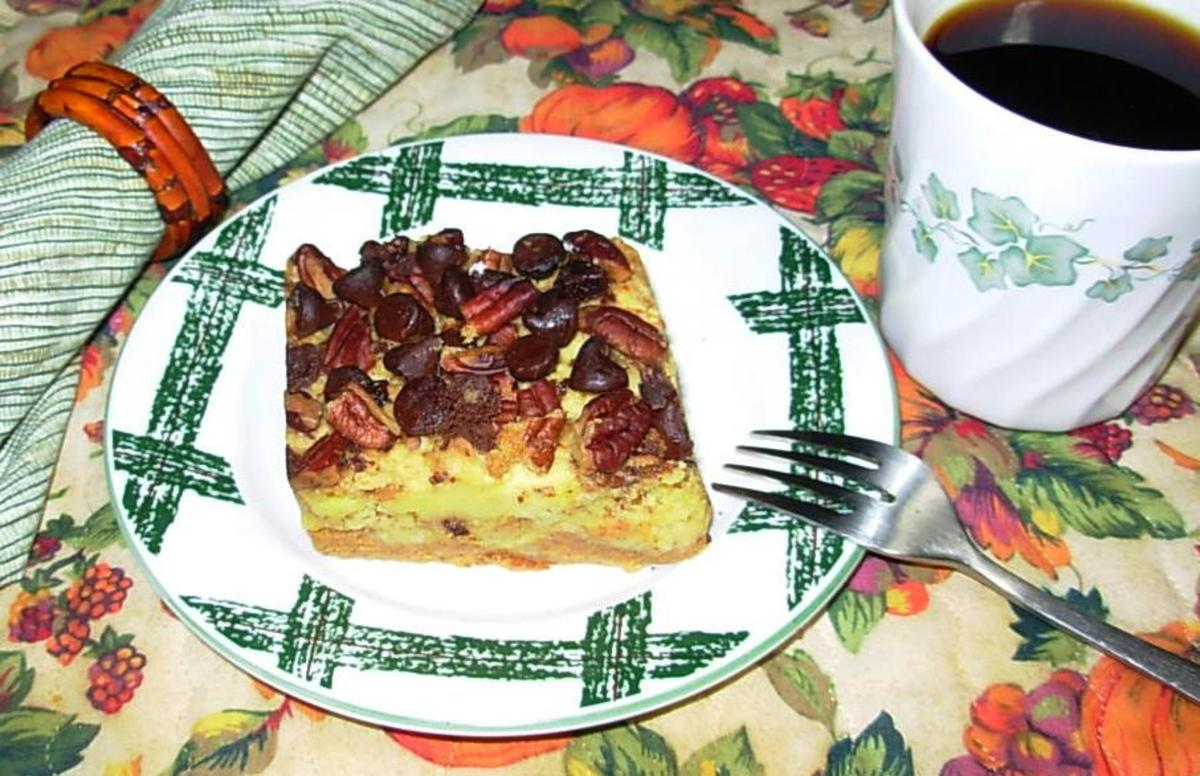 Pumpkin-pie-cake with chocolate pecan toping is a quick and easy to make. There's a layer of pumpkin pie filling on the bottom, then a layer f cake, and then it is topped with chocolate and pecans.