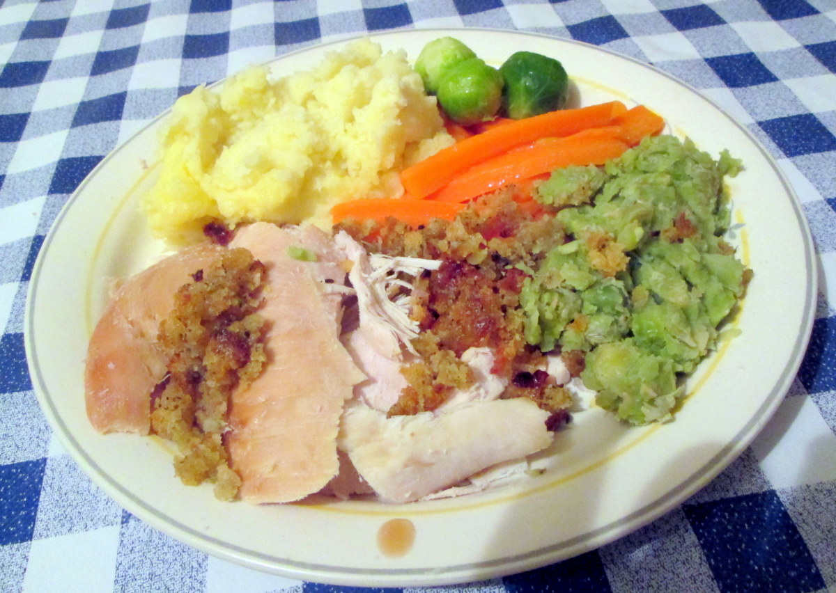 Enjoy your roast turkey dinner, shown here with various vegetable sides.