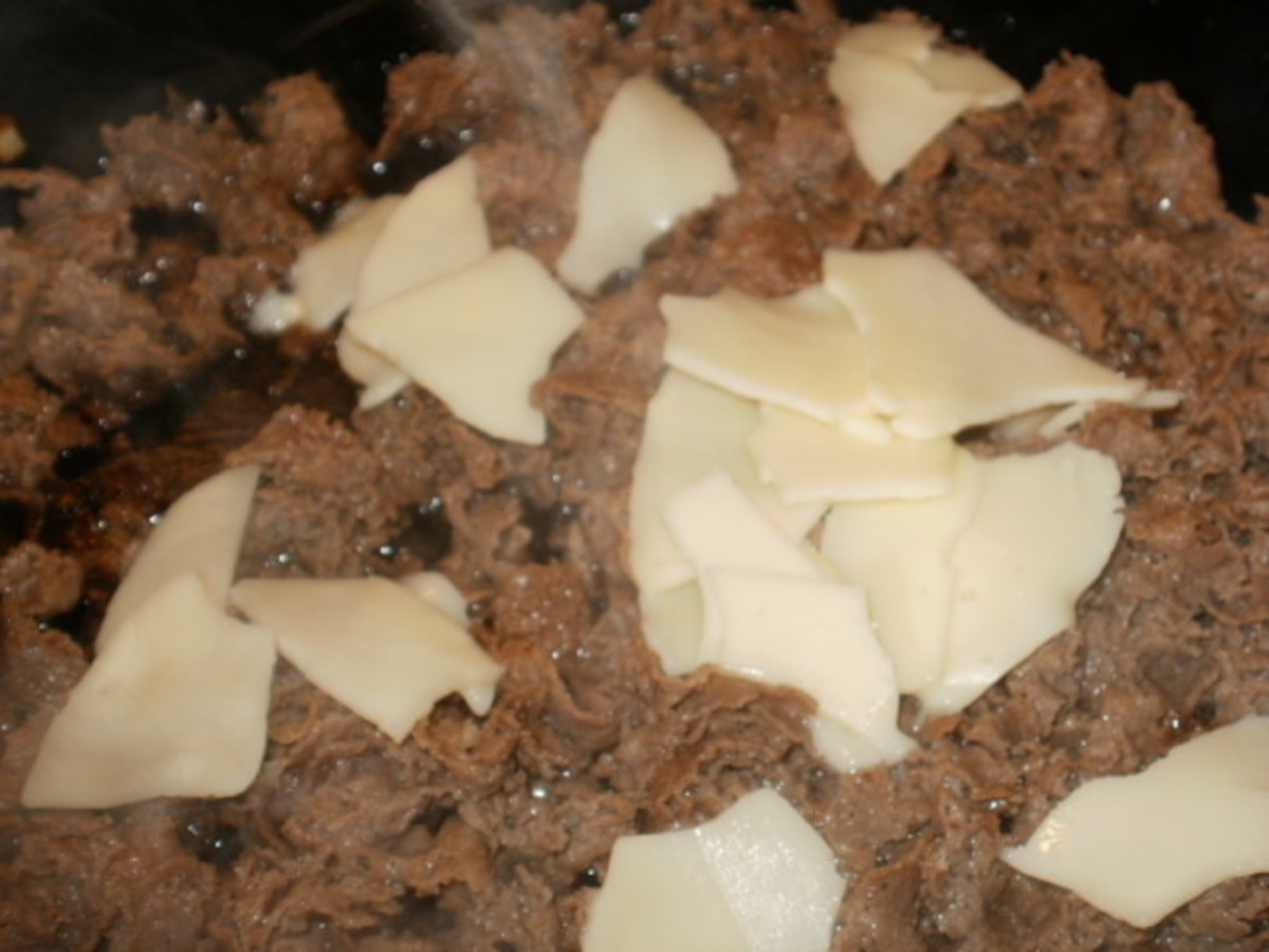 Add cheese to the meat and mix well as it melts