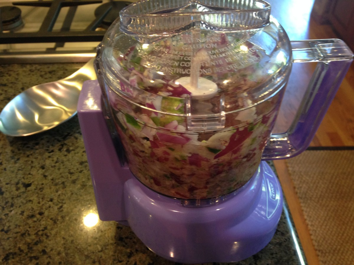 Step 3: 3. Throw Your Red Onion, Jalapeño and Tomato in a Mini Chopper