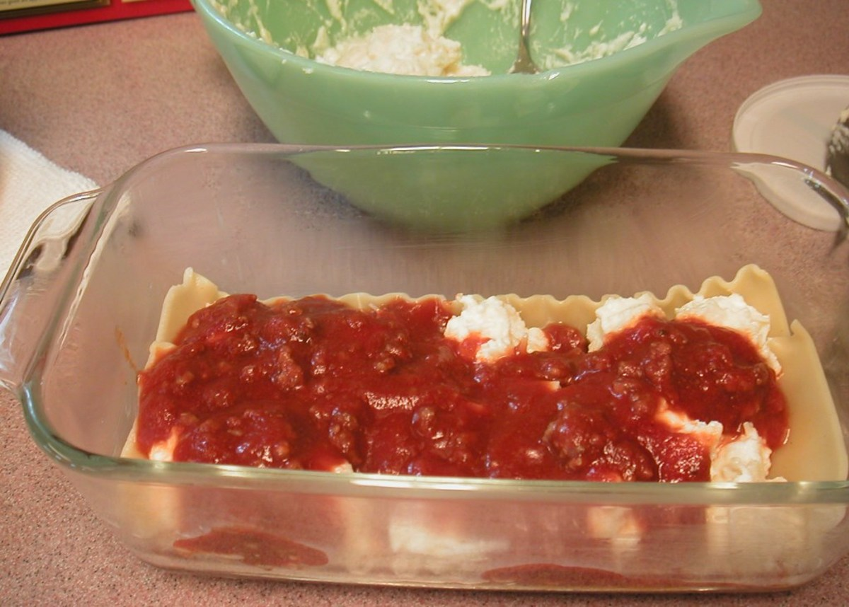 Spoon more sauce to cover the cheese mixture then continue layering the casserole ending with sauce on the top.