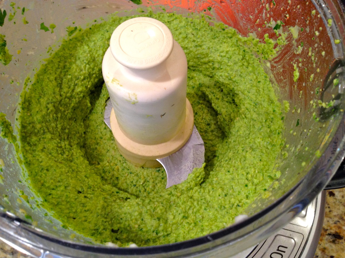 Process ingredients until smooth, adding liquid from garbanzo bean can a little at a time as needed until the hummus is at a desired consistency.