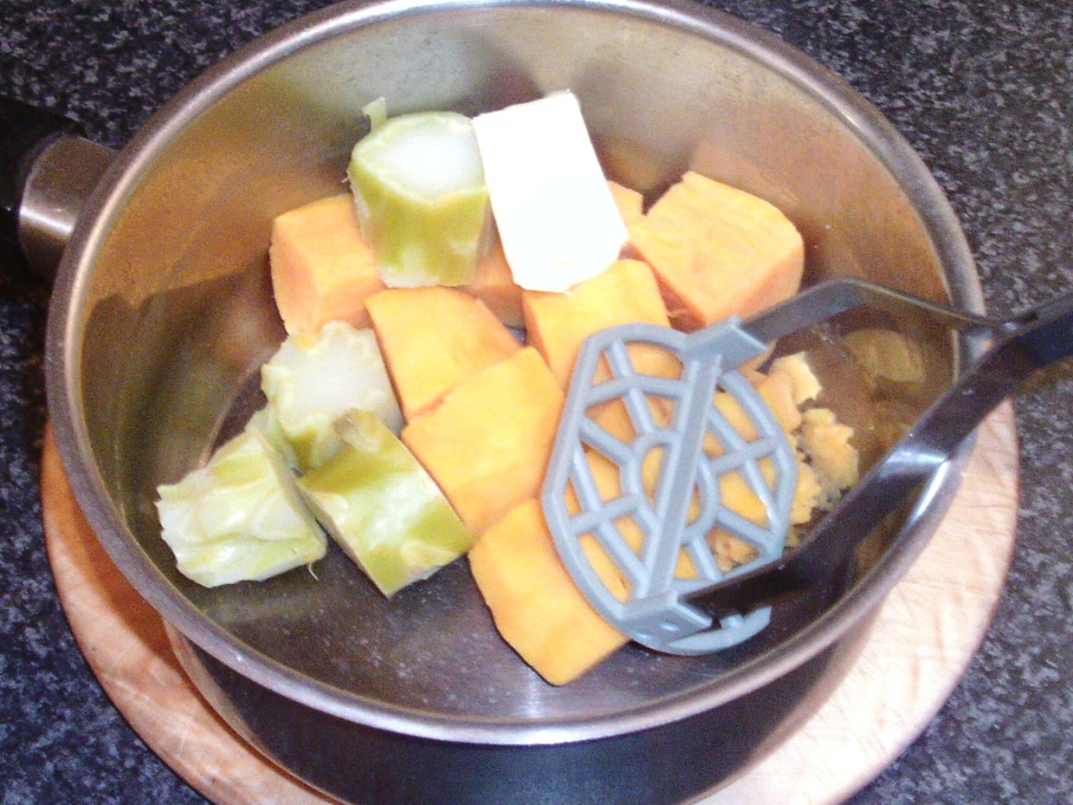 Preparing to mash sweet potato and broccoli stalk