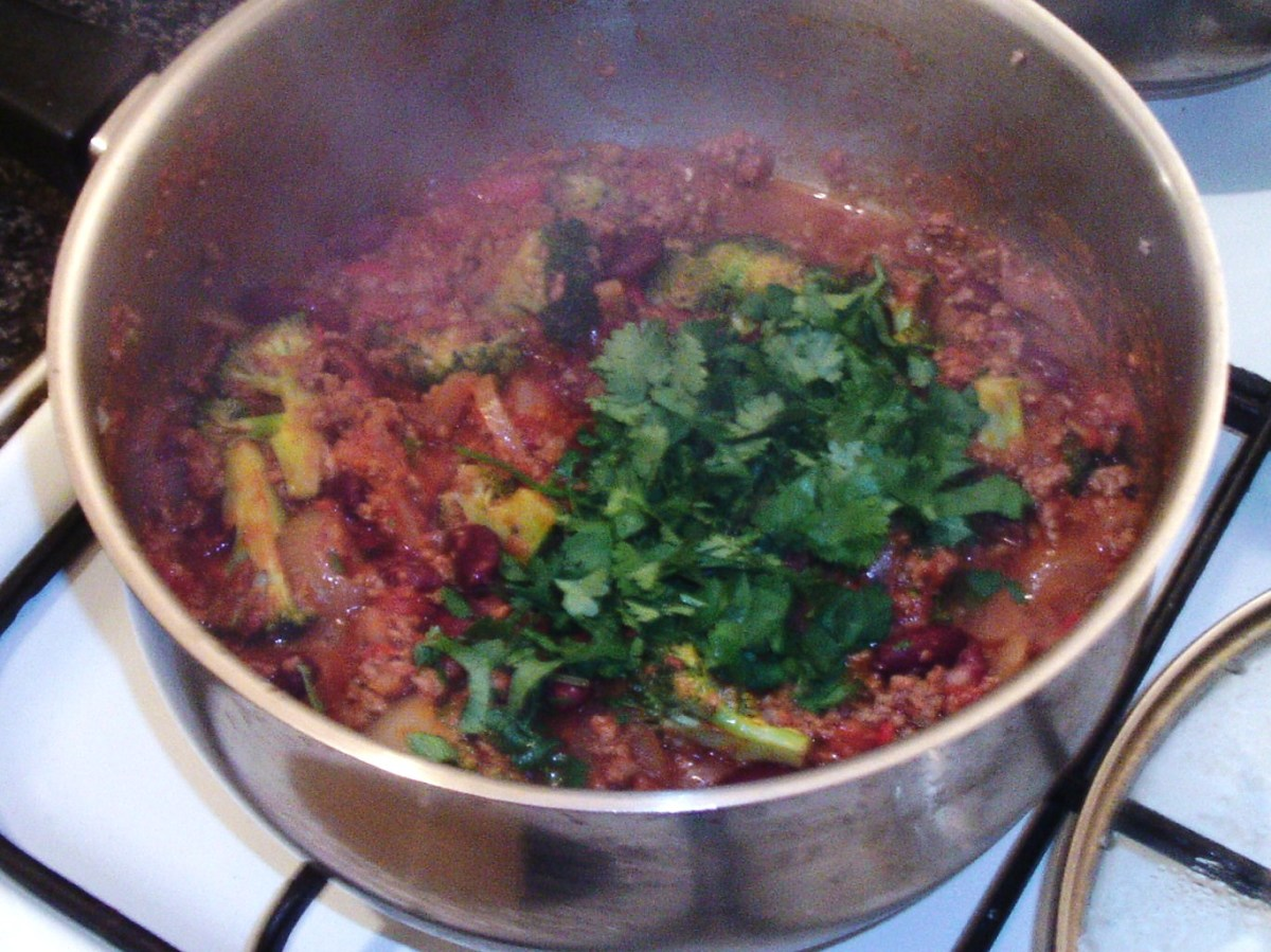 Chopped coriander is added to beef and broccoli chilli