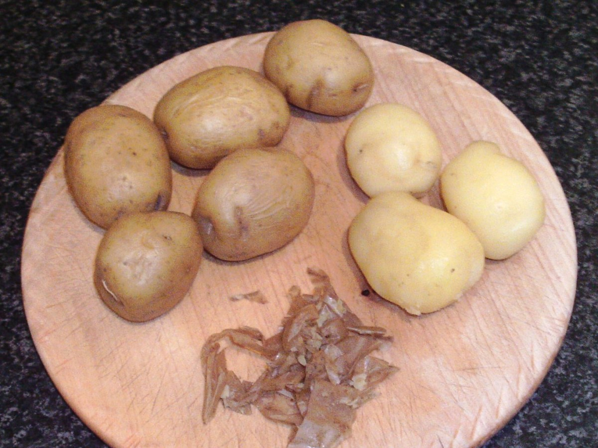 Cooked and cooled potatoes are carefully peeled for pan roasting