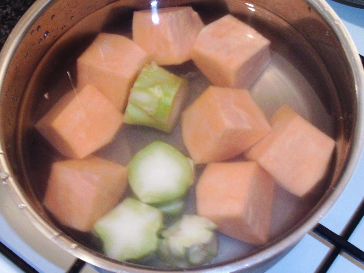Sweet potato and broccoli stalk is put on to boil