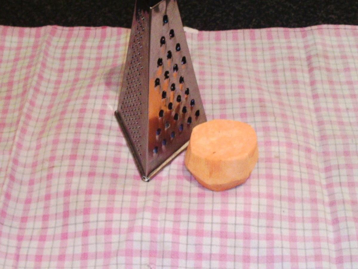 Preparing to grate sweet potato