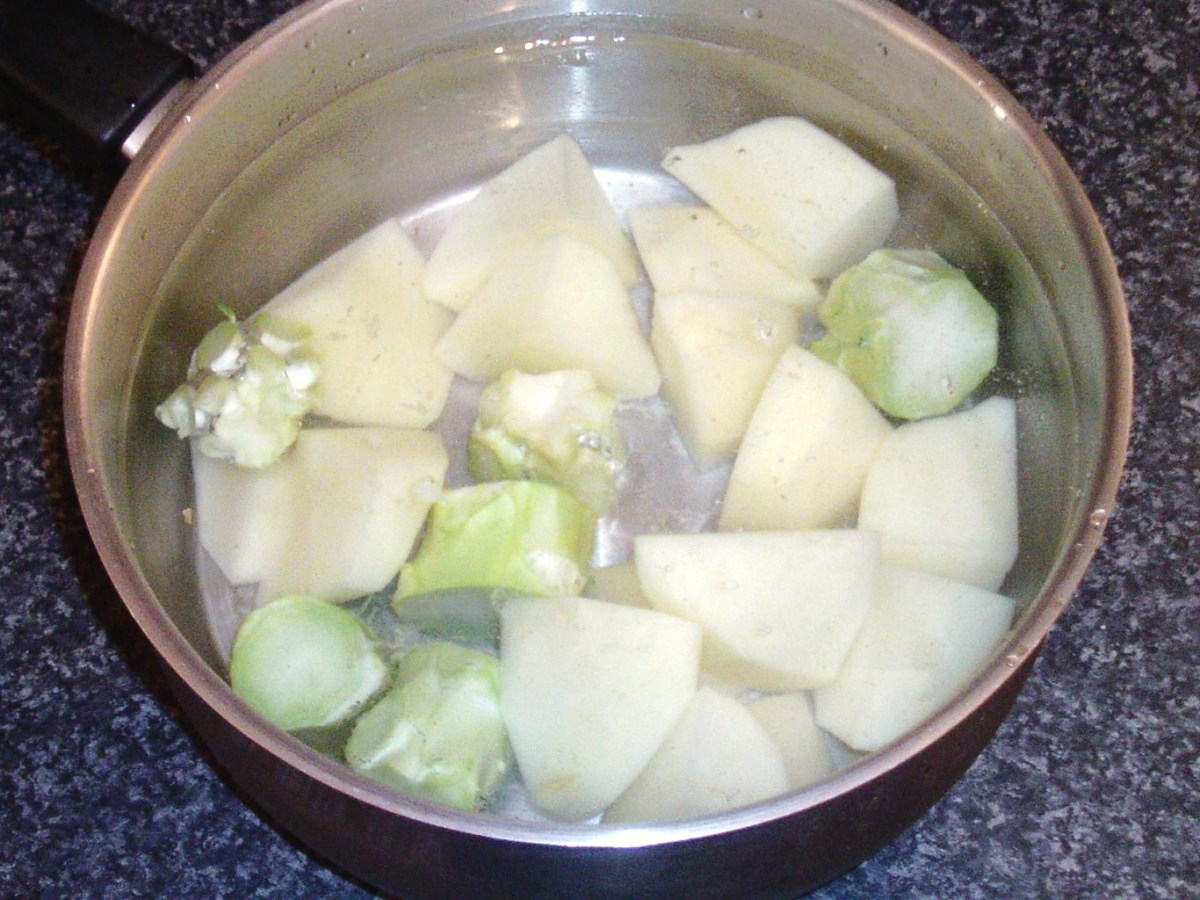 Potatoes and broccoli stalks ready for boiling
