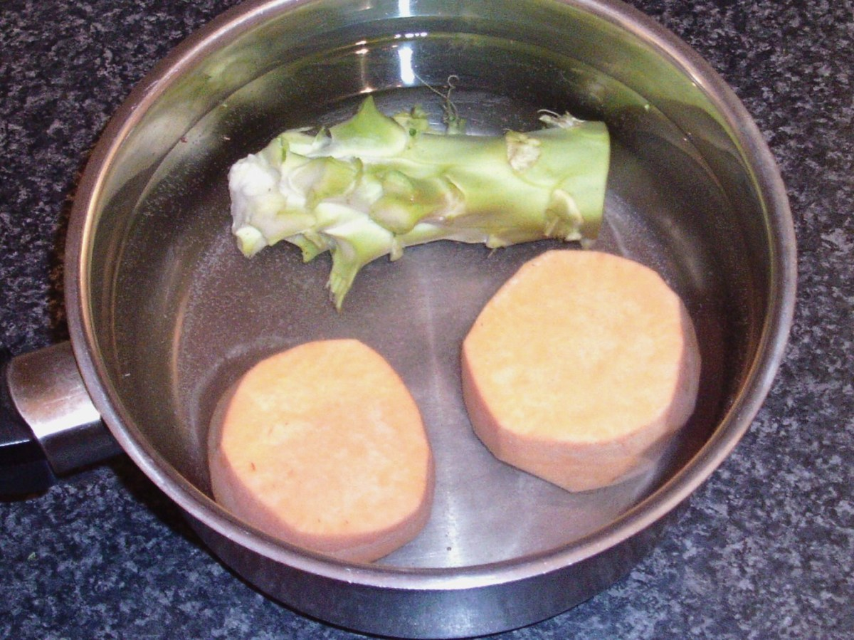 Half sweet potato and broccoli stalk are set aside in cold water