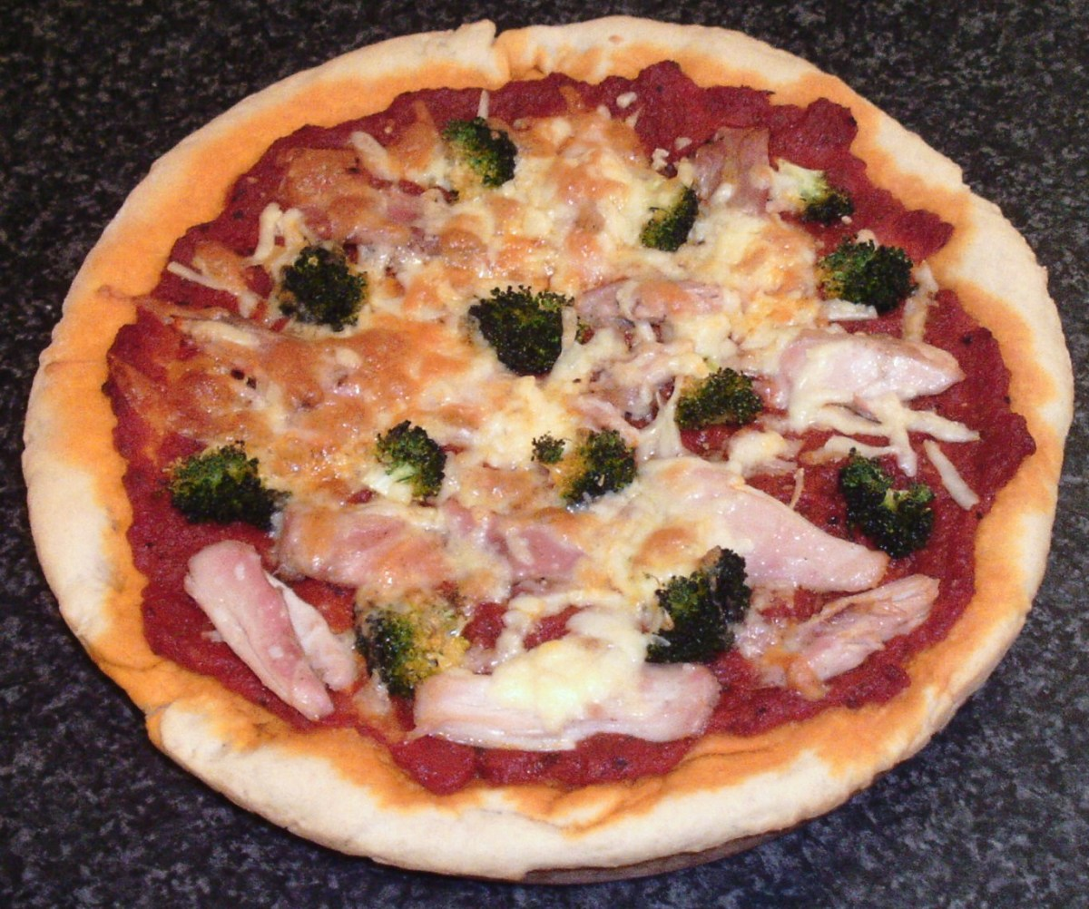 Pizza made from scratch topped with chicken thigh meat and broccoli
