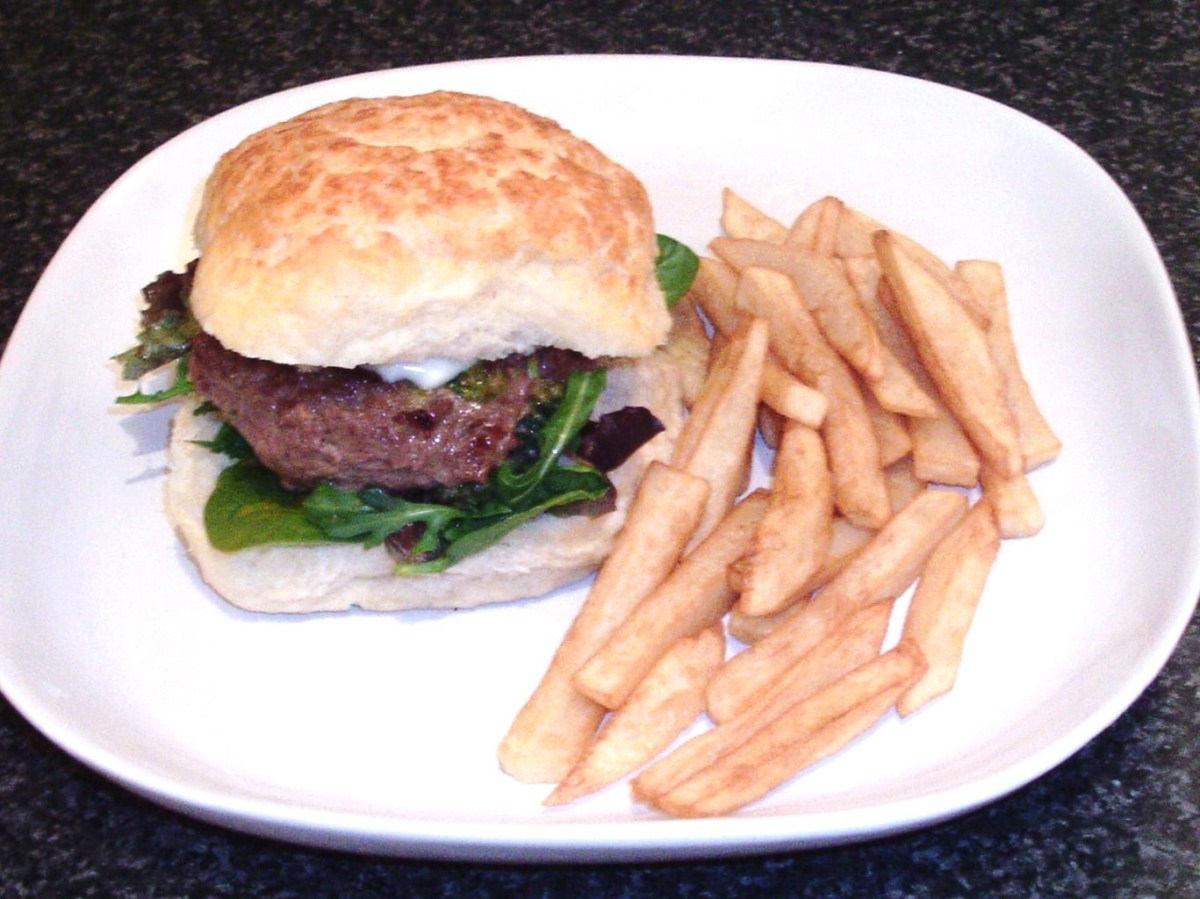 Beef and broccoli burger on a tiger roll with homemade fries