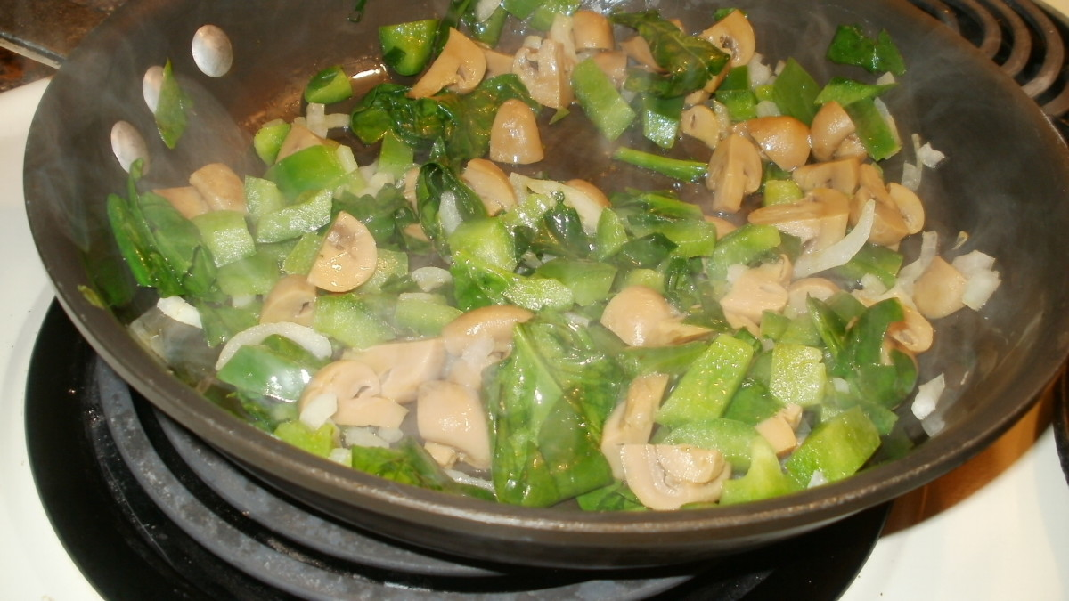 When spinach has wilted, mix with veggies