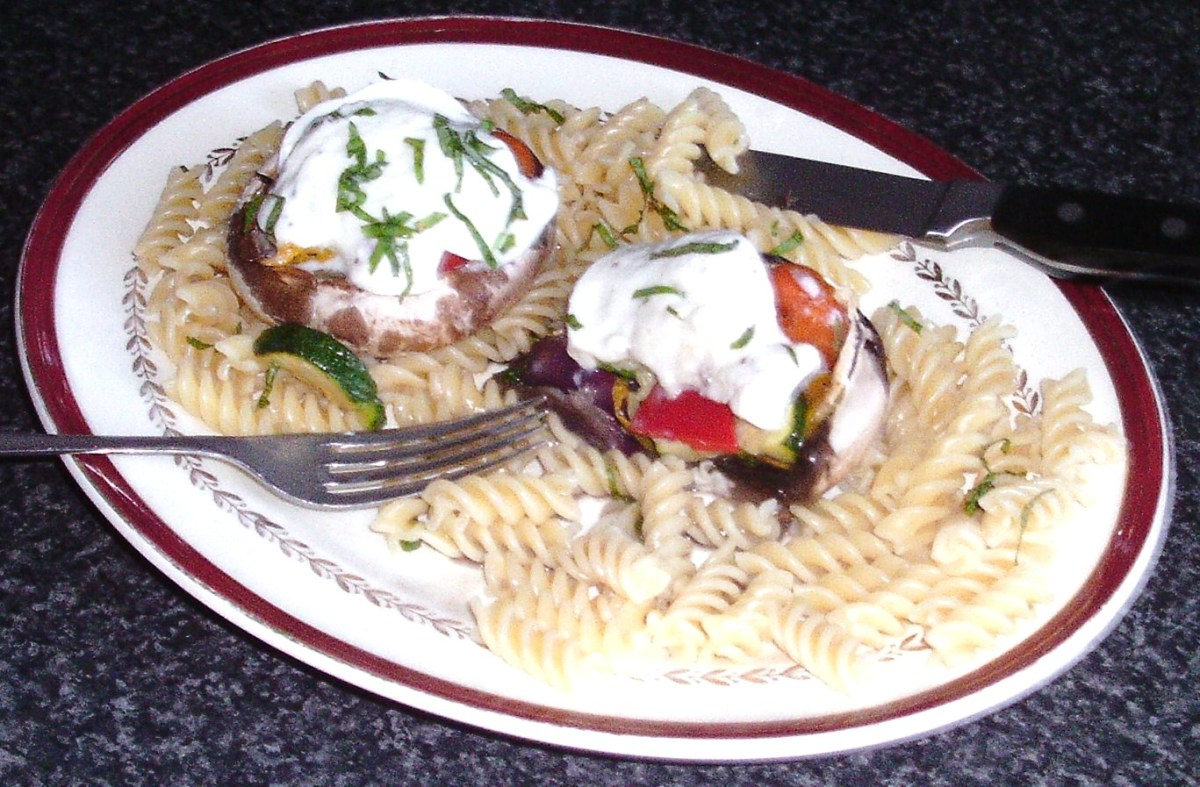 Enjoying Mediterranean vegetables stuffed mushrooms with mozzarella and fusilli
