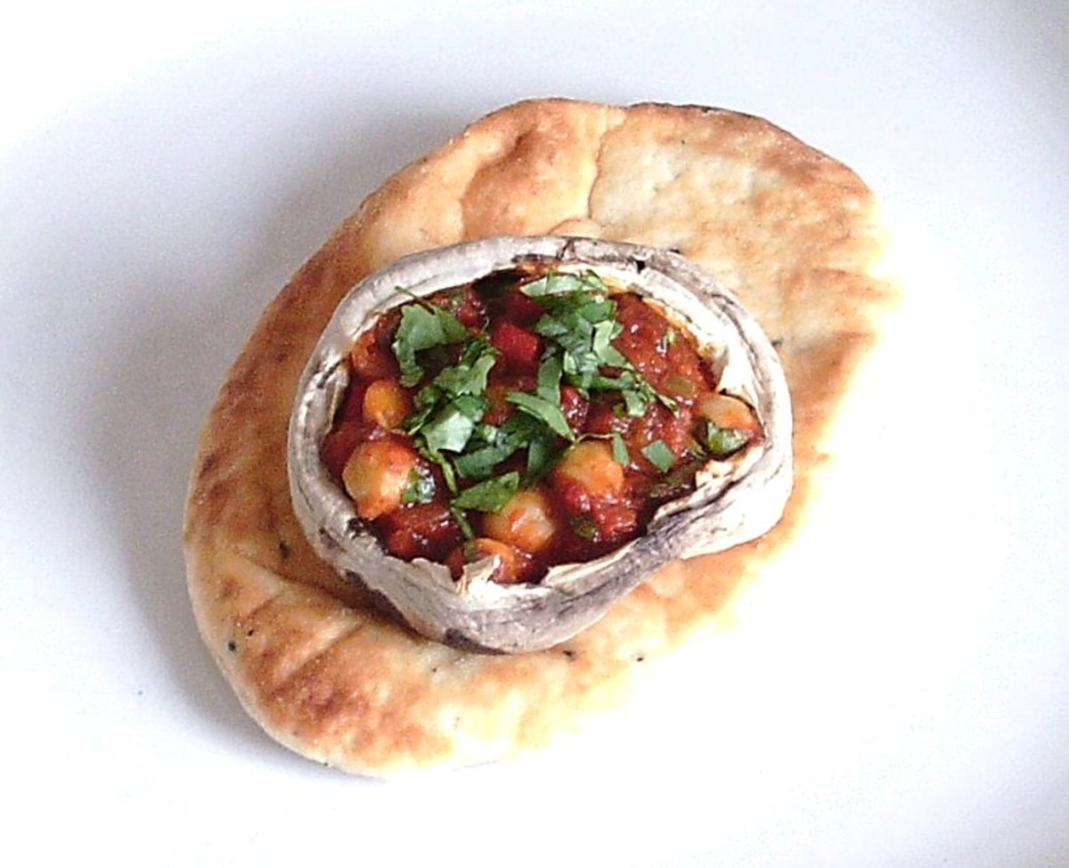 Homemade chickpea curry stuffed mushroom served on naan bread